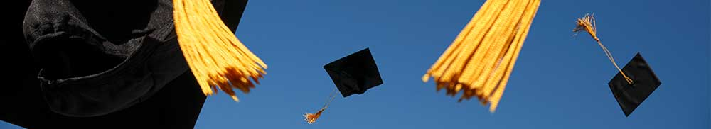 Picture - Graduation caps flying in the air